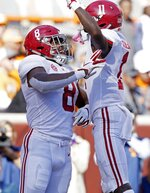 Alabama running back Josh Jacobs (8) celebrates a touchdown with teammate wide receiver Henry Ruggs III (11) in the first half of an NCAA college football game against Tennessee Saturday, Oct. 20, 2018, in Knoxville, Tenn. (AP Photo/Wade Payne)