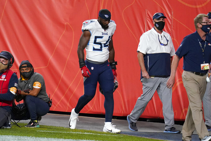 Tennessee Titans inside linebacker Rashaan Evans (54) leaves the field after being ejected during the first half of an NFL football game against the Denver Broncos, Monday, Sept. 14, 2020, in Denver. (AP Photo/Jack Dempsey)