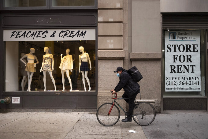 A retail location is for rent, Thursday, March 25, 2021, in the SoHo neighborhood of New York. The nation's business economists now expect slower economic growth this year due to the widespread delta variant of the coronavirus, while also saying the economy could improve more quickly next year as vaccinations become more accepted. (AP Photo/Mark Lennihan)