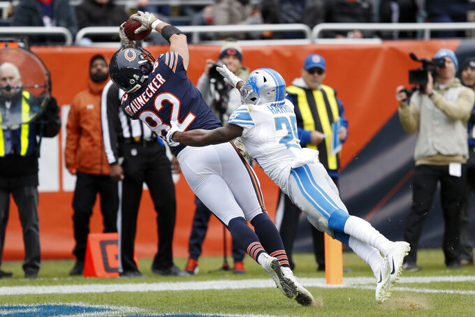Chicago Bears tight end Ben Braunecker (82) catches a 18-yard touchdown pass as Detroit Lions defensive back Will Harris (25) defends during the first half of an NFL football game in Chicago, Sunday, Nov. 10, 2019. (AP Photo/Charlie Neibergall)