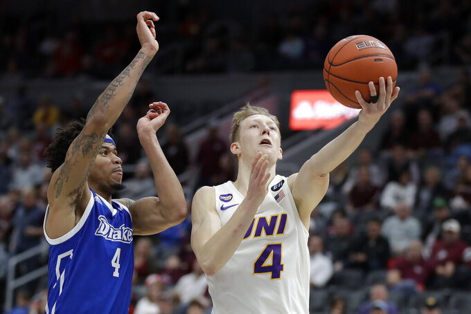 Northern Iowa's AJ Green, right, heads to the basket as Drake's Anthony Murphy defends during the second half of an NCAA college basketball game in the quarterfinal round of the Missouri Valley Conference men's tournament Friday, March 6, 2020, in St. Louis. (AP Photo/Jeff Roberson)