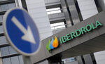 FILE - This Dec. 29, 2012, file photo ,shows the exterior of Spanish energy company Iberdrola is seen, in Madrid, Spain. The parent company of New Mexico's largest electric utility will become part of energy giant Iberdrola's global holdings under a multibillion-dollar merger.  Under the agreement announced Wednesday, Oct. 21, 2020, Iberdrola's majority-owned U.S. subsidiary Avangrid will acquire PNM Resources and its assets in New Mexico and Texas. The merger will require approval from a number of state and federal regulators in a process that's expected to take the next 12 months. (AP Photo/Andres Kudacki, File)