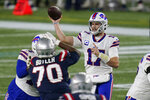Buffalo Bills quarterback Josh Allen passes under pressure from New England Patriots defensive lineman Adam Butler (70) in the first half of an NFL football game, Monday, Dec. 28, 2020, in Foxborough, Mass. (AP Photo/Charles Krupa)