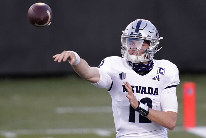 Nevada quarterback Carson Strong (12) throws against New Mexico during the first half of an NCAA college football game Saturday, Nov. 14, 2020, in Las Vegas. (AP Photo/John Locher)