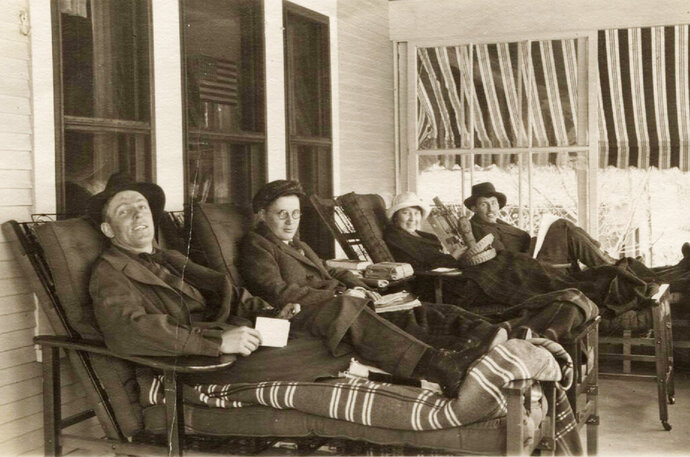 In this photo from the late 1800s provided by the Saranac Lake Free Library, tuberculosis patients rest on the porch of a sanatorium in Saranac Lake, N.Y. The local boom ended with the rise of effective antibiotic treatment in the 1950s, but residents still honor the village's novel legacy. (Saranac Lake Free Library via AP)