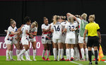 Britain players celebrate after Ellen White scores her opening goal during a women's soccer match against Japan at the 2020 Summer Olympics, Saturday, July 24, 2021, in Sapporo, Japan. (AP Photo/Silvia Izquierdo)