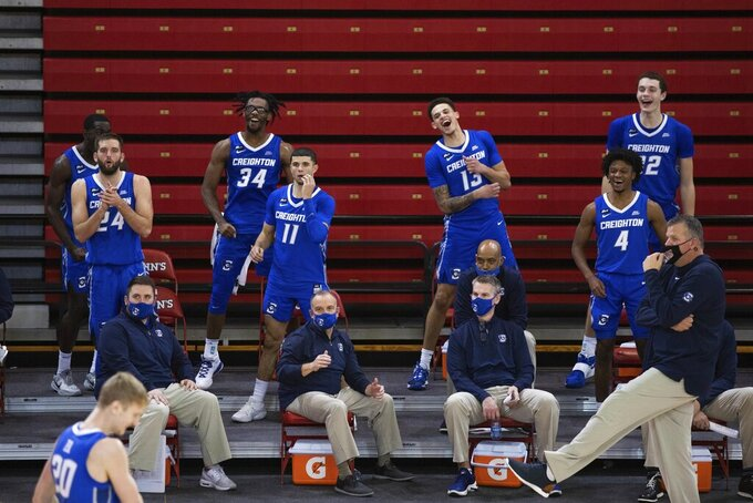 The Creighton bench cheers at the end of second half of an NCAA college basketball game against St. John's, Thursday, Dec. 17, 2020, in New York. (AP Photo/Kevin Hagen)