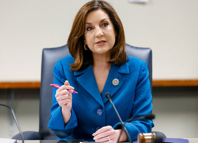 FILE - In this March 16, 2020 file photo, Oklahoma's State Superintendent of Public Instruction Joy Hofmeister speaks during an emergency meeting of the Oklahoma State Department of Education in Oklahoma City. The Oklahoma State Board of Education approved a COVID-19 response plan on Thursday, July 23, 2020, for actions local districts should take to slow the spread of coronavirus, but narrowly voted to make the plan optional instead of mandatory. (Chris Landsberger/The Oklahoman via AP, File)