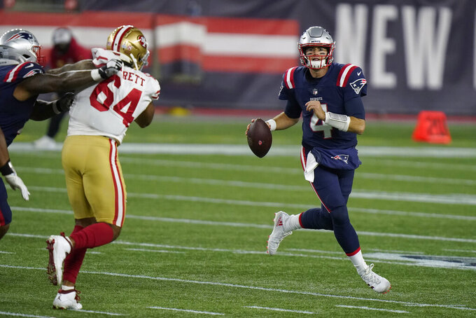 New England Patriots quarterback Jarrett Stidham rolls out to pass against the San Francisco 49ers in the second half of an NFL football game, Sunday, Oct. 25, 2020, in Foxborough, Mass. (AP Photo/Steven Senne)