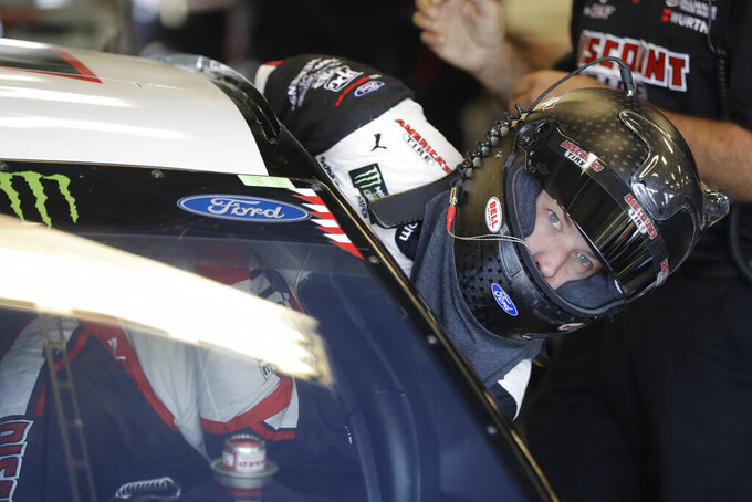Monster Energy NASCAR Cup Series driver Brad Keselowski climbs into his car during practice for the NASCAR Brickyard 400 auto race at the Indianapolis Motor Speedway, Saturday, Sept. 7, 2019 in Indianapolis. (AP Photo/Darron Cummings)