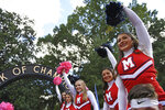 Mississippi cheerleaders cheer during the Walk of Champions in the Grove before an NCAA college football game between Mississippi and Texas A&M in Oxford, Miss., Saturday, Oct. 19, 2019. Football is being played in the Power Five conferences, but many of the longstanding traditions that go along with the games are on hold during the coronavirus pandemic. (AP Photo/Thomas Graning)