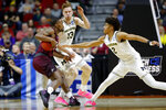 Montana guard Sayeed Pridgett, left, drives between Michigan's Ignas Brazdeikis (13) and Jordan Poole, right during a first round men's college basketball game in the NCAA Tournament, Thursday, March 21, 2019, in Des Moines, Iowa. (AP Photo/Charlie Neibergall)