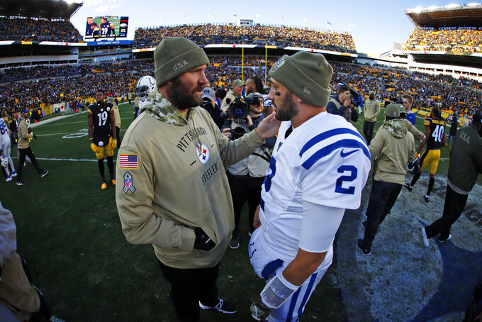 Pittsburgh Steelers quarterback Ben Roethlisberger, left, talks with Indianapolis Colts quarterback Brian Hoyer (2) following an NFL football game in Pittsburgh, Sunday, Nov. 3, 2019. (AP Photo/Gene J. Puskar)