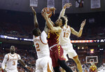 Iowa State guard Lindell Wigginton (5) drives to the basket against Texas guard Matt Coleman III (2) and forward Jaxson Hayes (10) during the first half of an NCAA college basketball game, Saturday, March 2, 2019, in Austin, Texas. (AP Photo/Eric Gay)