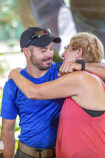 Julia Eller, right, mother of Amanda Eller, hugs rescue lead Javier Cantellops during a news conference about the rescue of Amanda Eller on Saturday, May 25, 2019 in Wailuku Maui. The Maui News reported Friday Amanda Eller was found injured in the Makawao Forest Reserve. Family spokeswoman Sarah Haynes confirmed she spoke with Eller's father John. Eller was airlifted to safety. (Bryan Berkowitz/Honolulu Star-Advertiser via AP)