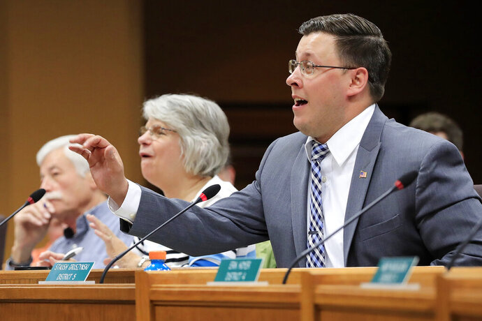 FILE - Then-Brown County Supervisor Staush Gruszynski speaks May 17, 2017 at a Brown County Board of Supervisors meeting at City Hall in Green Bay, Wis. The state Assembly's chief clerk has released records that show a legislative aide accused Gruszynski of trying to coax her into having sex with him last year. (Adam Wesley/The Green Bay Press-Gazette via AP, File)