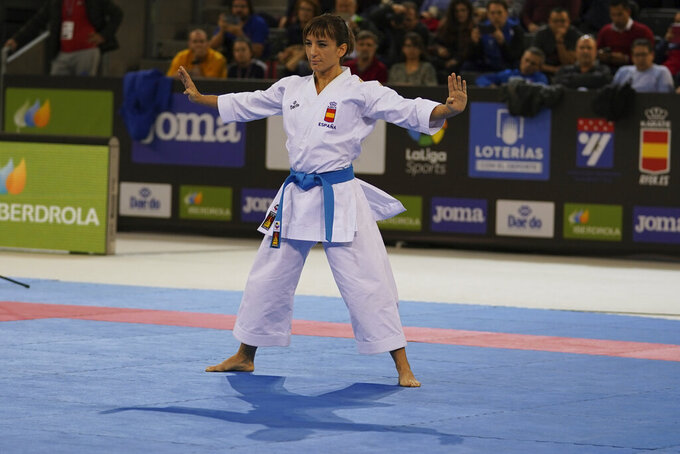 In this photo provided by the Spanish karate federation, Spanish karate athlete Sandra Sanchez takes part in a Senior Female Kata - Final bout in Madrid, Spain on Dec. 1, 2019.  Personal determination has taken Sanchez to the top of the world rankings, and in a few months from now the 38-year old will reach the biggest moment of her career by competing in the inaugural Olympic karate tournament at the upcoming summer Tokyo Olympic Games. (Xavier Servolle/Kphotos Via AP)