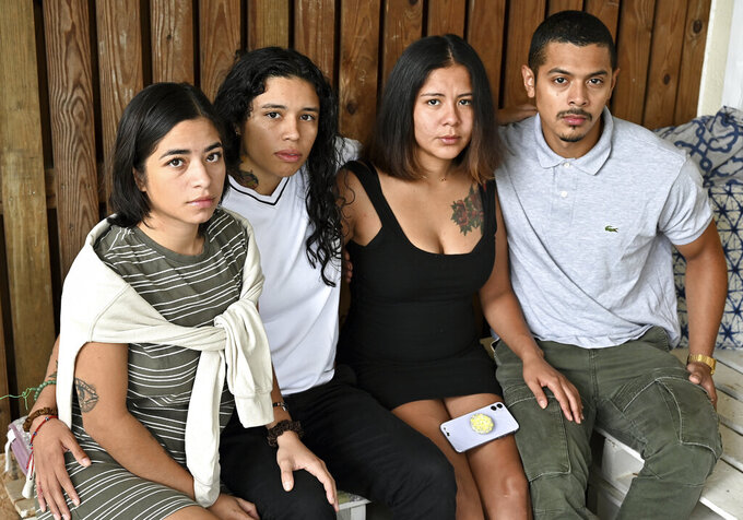 This Sept. 5, 2021, photo shows Erika Erazo, Erica Umana, Dayri Amaya and Brandon Cuevas, who alleged that Prince George's County law enforcement barged into their apartment and tased and killing their dog as well in Landover Hills, Md. Several officers have been suspended and the whole incident is under investigation. (Marvin Joseph/The Washington Post via AP)