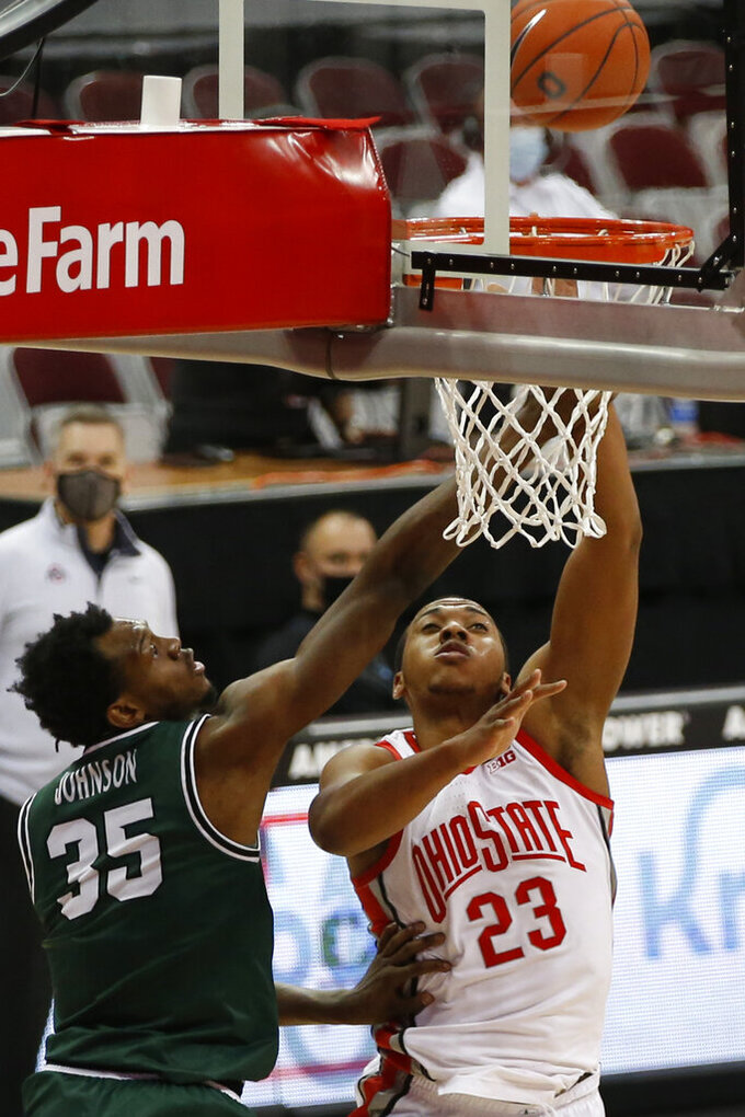 Ohio State's Zed Key, right, shoots over Cleveland State's Deante Johnson during the second half of an NCAA college basketball game Sunday, Dec. 13, 2020, in Columbus, Ohio.  (AP Photo/Jay LaPrete)