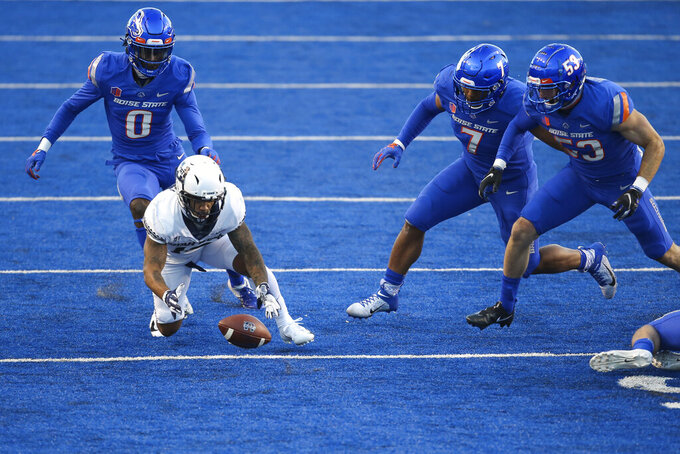 Utah State wide receiver Jordan Nathan (16) dives on a fumbled ball as Boise State safety Jl Skinner (0), Boise State linebacker Ezekiel Noa (7) and Boise State defensive end Sam Whitney (53) close in during the first half in an NCAA college football game Saturday, Oct. 24, 2020, in Boise, Idaho. (AP Photo/Steve Conner)