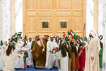 In this Wednesday, Nov. 27, 2019, photo released by Ministry of Presidential Affairs, Saudi Crown Prince Mohammed bin Salman, center left, and Abu Dhabi Crown Prince Mohammed bin Zayed Al Nahyan, center right, are greeted by the Emirati children at Qasr Al Watan in Abu Dhabi, United Arab Emirates. Saudi crown prince is in the United Arab Emirates for talks that are expected to focus on the war in Yemen and tensions with Iran. (Mohamed Al Hammadi/Ministry of Presidential Affairs via AP)