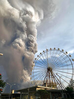 In this Jan. 12, 2020, photo, Taal volcano releases ash and smoke during an eruption in Tagaytay, Cavite province south of Manila, Philippines. (AP Photo/Bullit Marquez)