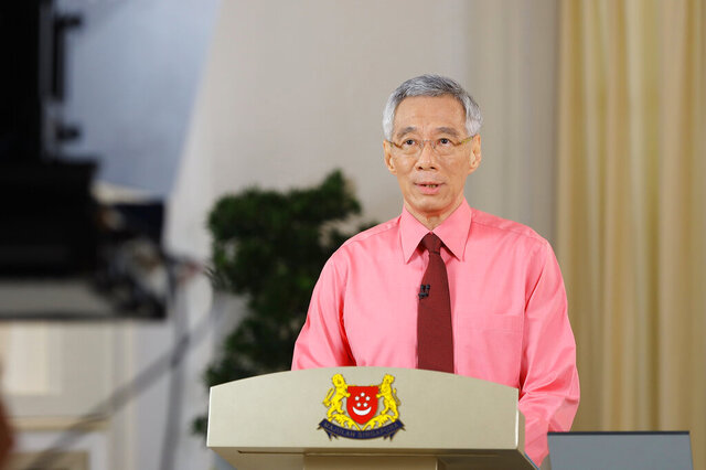 In this photo provided by Singapore Ministry of Communications and Information on Tuesday, June 23, 2020, Singapore Prime Minister Lee Hsien Loong makes an announcement about general elections in Singapore. Lee called for early elections to seek a fresh mandate despite the coronavirus pandemic. (Singapore Ministry of Communications and Information via AP)