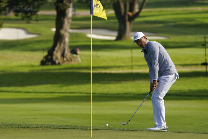 Haotong Li of China, chips to the green on the seventh hole during the second round of the PGA Championship golf tournament at TPC Harding Park Friday, Aug. 7, 2020, in San Francisco. (AP Photo/Charlie Riedel)