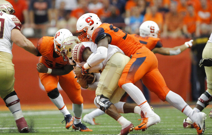 Syracuse's Jake Pickard, right, sacks Florida State's Deondre Francois, left, in the fourth quarter of an NCAA college football game in Syracuse, N.Y., Saturday, Sept. 15, 2018. Syracuse won 30-7. (AP Photo/Nick Lisi)