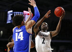 Cincinnati guard Keith Williams (2) shoots around Memphis forward Isaiah Maurice (14) during the first half of an NCAA college basketball game Saturday, March 2, 2019, in Cincinnati. (AP Photo/Gary Landers)