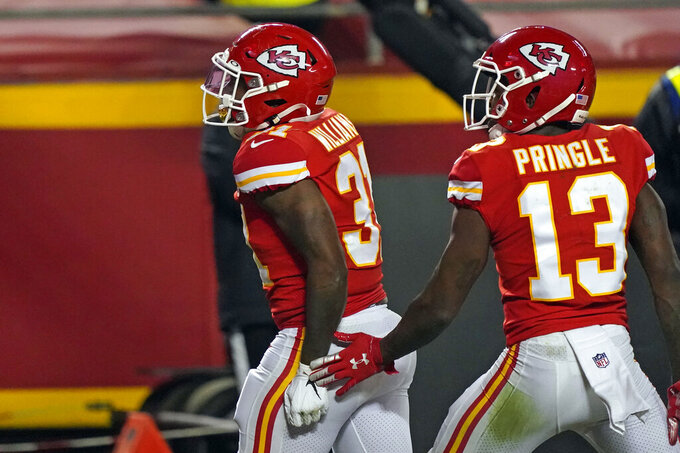 Kansas City Chiefs running back Darrel Williams, left, celebrates with teammate Byron Pringle (13) after scoring on a 6-yard touchdown run in the first half of the AFC championship NFL football game, Sunday, Jan. 24, 2021, in Kansas City, Mo. (AP Photo/Jeff Roberson)