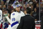 Tampa Bay Lightning goaltender Andrei Vasilevskiy (88) speaks with Carolina Hurricanes coach Rod Brind'Amour following Game 5 of an NHL hockey Stanley Cup second-round playoff series in Raleigh, N.C., Tuesday, June 8, 2021. (AP Photo/Gerry Broome)