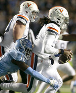 Virginia quarterback Bryce Perkins (3) is sacked by North Carolina's D.J. Ford on third down for a 7-yard loss during the second quarter of an NCAA college football game Saturday, Nov. 2, 2019, in Chapel Hill, N.C. (Robert Willett/The News & Observer via AP)