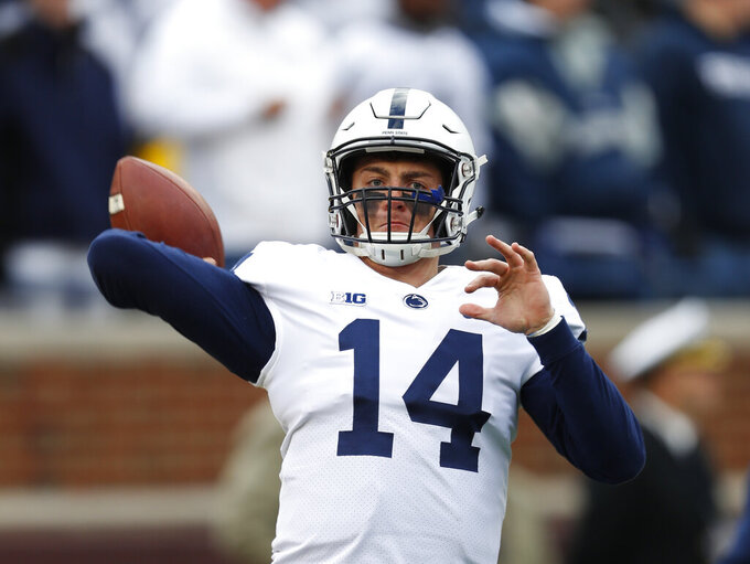 FILE - In this Nov. 3, 2018, file photo, Penn State quarterback Sean Clifford (14) warms up before an NCAA college football game against Michigan in Ann Arbor, Mich. Clifford always planned to be Penn State's starting quarterback. The opportunity came sooner than even he expected. Clifford has huge task in replacing Trace McSorley, but he sounds and looks the part. (AP Photo/Paul Sancya, File)