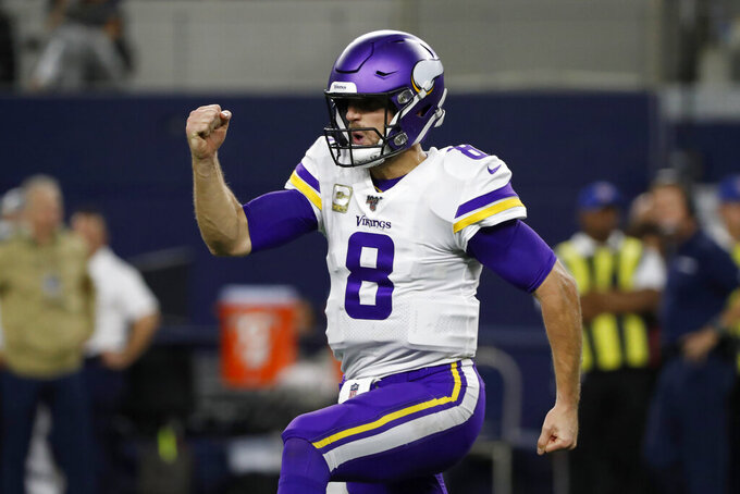 Minnesota Vikings quarterback Kirk Cousins celebrates in the second half of NFL football game against the Dallas Cowboys in Arlington, Texas, Sunday, Nov. 10, 2019. (AP Photo/Roger Steinman)
