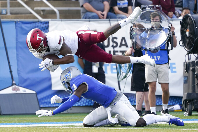 Troy wide receiver Khalil McClain, top, makes a catch over Middle Tennessee safety Gregory Grate Jr. (3) in the first half of an NCAA college football game Saturday, Sept. 19, 2020, in Murfreesboro, Tenn. (AP Photo/Mark Humphrey)