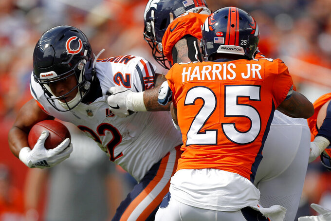 Chicago Bears running back David Montgomery (32) is hit by DUPLICATE***Denver Broncos running back Theo Riddick (25)***Denver Broncos cornerback Chris Harris (25) during the first half of an NFL football game, Sunday, Sept. 15, 2019, in Denver. (AP Photo/David Zalubowski)