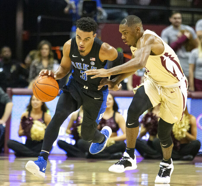Florida State guard Trent Forrest, right, attempts a steal against Duke guard Tre Jones brings the ball upcourt in the first half of an NCAA college basketball game in Tallahassee, Fla., Saturday, Jan. 12, 2019. (AP Photo/Mark Wallheiser)