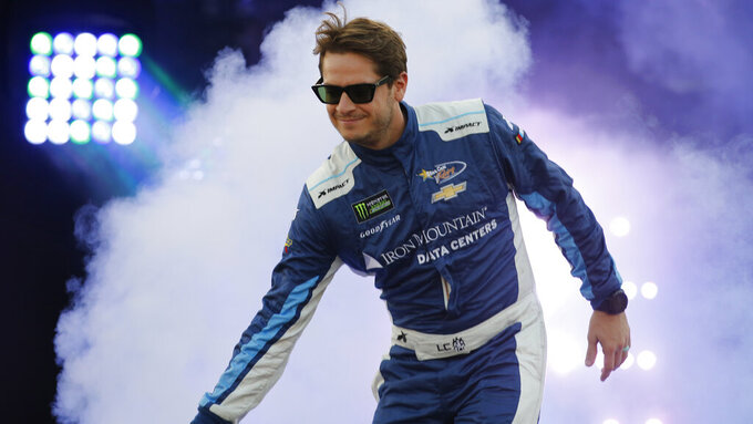 Landon Cassill greets fans during driver introductions for the NASCAR Monster Energy Cup series auto race at Richmond Raceway in Richmond, Va., Saturday, Sept. 21, 2019. (AP Photo/Steve Helber)