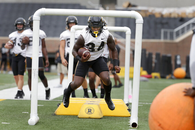 Missouri running back Larry Rountree III takes part in a drill during an NCAA college football practice Monday, Aug. 12, 2019, in Columbia, Mo. (AP Photo/Jeff Roberson)