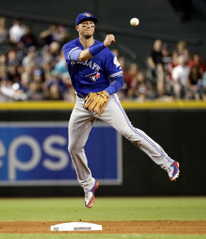 FILE - In this July 20, 2016, file photo, Toronto Blue Jays' Troy Tulowitzki throws out Arizona Diamondbacks' Brandon Drury during the fourth inning of an interleague baseball game, in Phoenix. The Yankees have obtained a low-cost infield replacement, agreeing to a one-year contract with shortstop Troy Tulowitzki for the major league minimum $555,000, a person familiar with the negotiations told The Associated Press. The person spoke on condition of anonymity Wednesday, Jan. 2, 2019, because the agreement, first reported by ESPN, is subject to a successful physical. (AP Photo/Matt York, File)