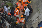 A man is rescued from the debris after a residential building collapsed in Bhiwandi in Thane district, a suburb of Mumbai, India, Monday, Sept.21, 2020. (AP Photo/Praful Gangurde)
