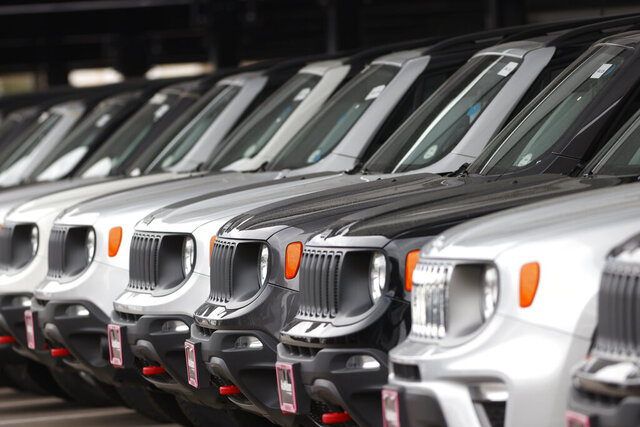 FILE - In this Sunday, April 26, 2020, photograph, a long row of unsold 2020 Renegades sits at a Chrysler/Jeep dealership in Englewood, Colo.  Edmunds analysts had anticipated more than a million leased vehicles coming back to car dealerships this quarter. But due to countless shelter-in-place orders due to coronavirus concerns, many people will face the question of how to safely handle their vehicle's lease return or whether they can return their vehicle at all.(AP Photo/David Zalubowski)