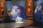 This 2004 image released by PBS shows journalist Jim Lehrer on the set of