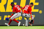 Washington Nationals center fielder Victor Robles (16) and left fielder Juan Soto both overrun a line drive by Atlanta Braves' Freddie Freeman during the seventh inning of a baseball game Sunday, July 21, 2019, in Atlanta. Ronald Acuna scored. (AP Photo/John Amis)
