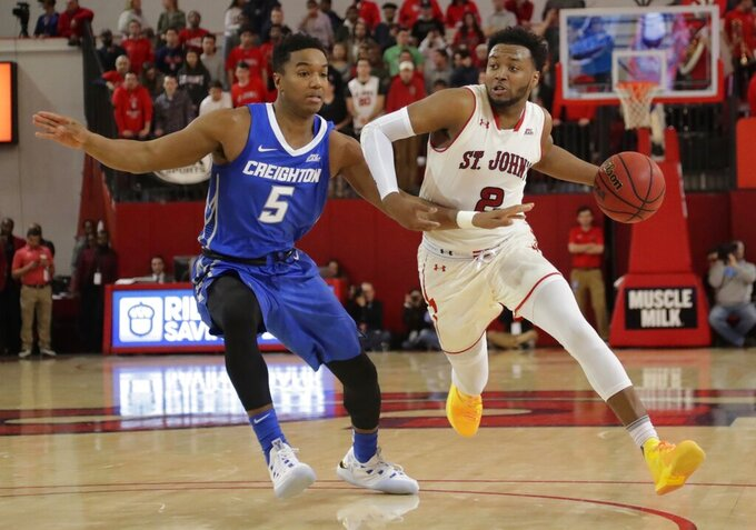 St. John's Shamorie Ponds (2) drives past Creighton's Ty-Shon Alexander (5) during the second half of an NCAA college basketball game Wednesday, Jan. 16, 2019, in New York. St. John's won 81-66. (AP Photo/Frank Franklin II)