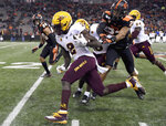 FILE - In this Nov. 16, 2019, file photo, Arizona State wide receiver Brandon Aiyuk dashes past Oregon State defensive back Isaiah Dunn during the first half of an NCAA football game, in Corvallis, Ore. Aiyuk was selected to The Associated Press All-Pac 12 Conference team, Thursday, Dec. 12, 2019.  (AP Photo/Steve Dykes, File)