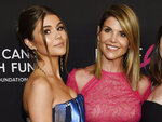 FILE - In this Feb. 28, 2019 file photo, actress Lori Loughlin poses with her daughter Olivia Jade Giannulli, left, at the 2019