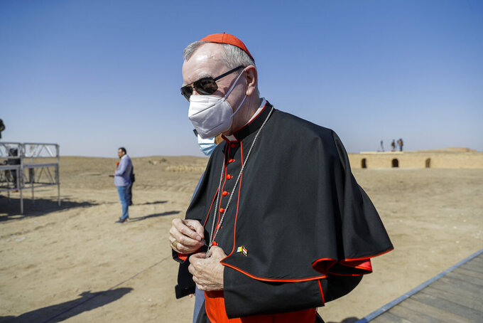 """FILE - In this file photo taken on March 6, 2021, Vatican Secretary of State Cardinal Pietro Parolin arrives ahead of an interreligious meeting with Pope Francis near the archaeological area of the Sumerian city-state of Ur, 20 kilometers south-west of Nasiriyah, Iraq. The Vatican No. 2 is skipping a planned trip to Venezuela this week because of the coronavirus pandemic. Cardinal Pietro Parolin, the Vatican's former ambassador to Caracas, had planned to celebrate the April 30 beatification of Jose Gregorio Hernandez, dubbed the """"doctor of the poor."""" The Vatican said Wednesday that due to issues linked to the pandemic, Parolin wouldn't make the trip. (AP Photo/Andrew Medichini/FILE)"""