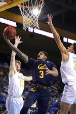 California guard Paris Austin, center, shoots as UCLA guard Jake Kyman, left, and guard Jules Bernard defend during the first half of an NCAA college basketball game Sunday, Jan. 19, 2020, in Los Angeles. (AP Photo/Mark J. Terrill)